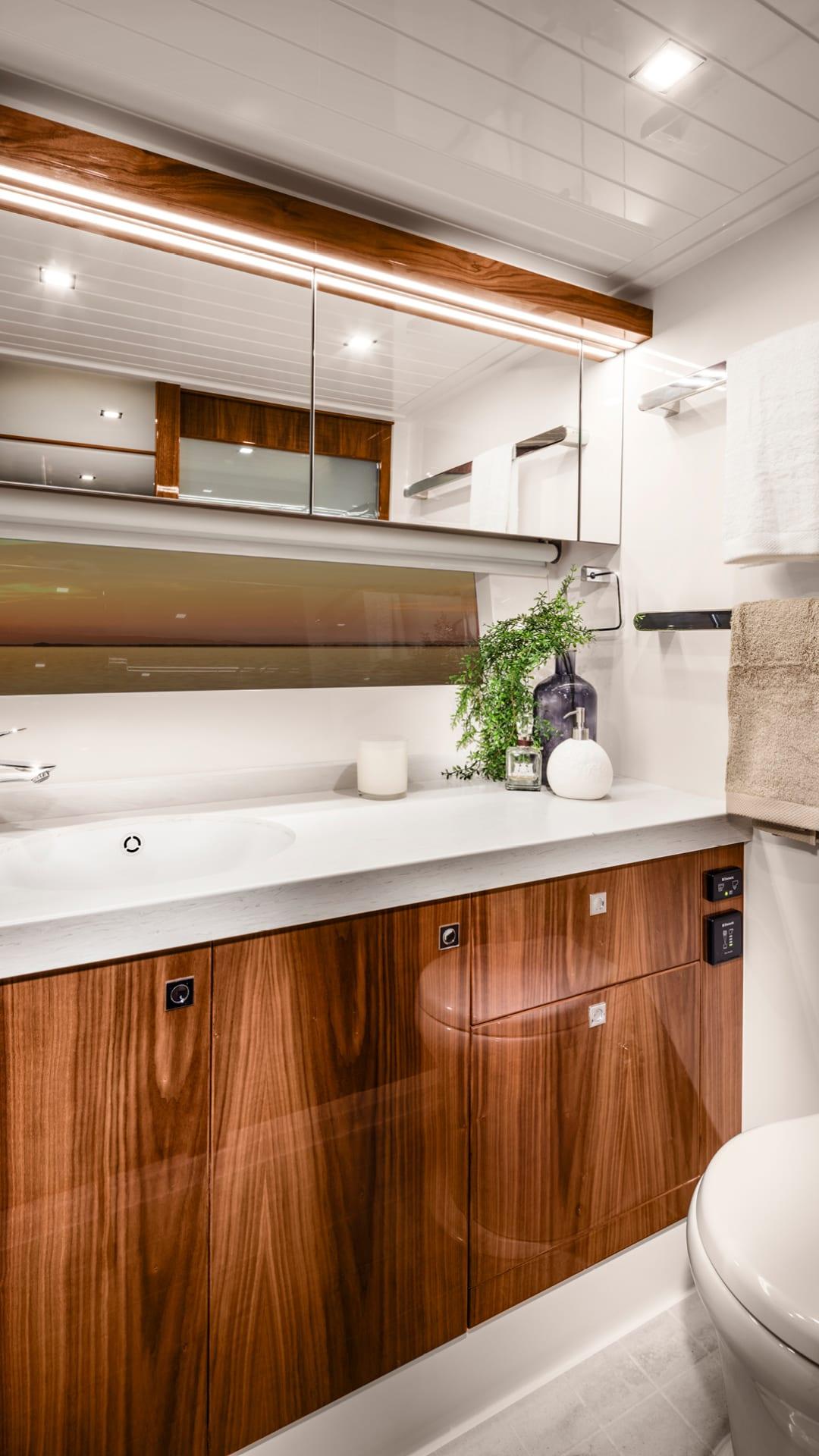 Riviera 72 Sports Motor Yacht Classic Master Ensuite 01 – Gloss Walnut Timber Finish
