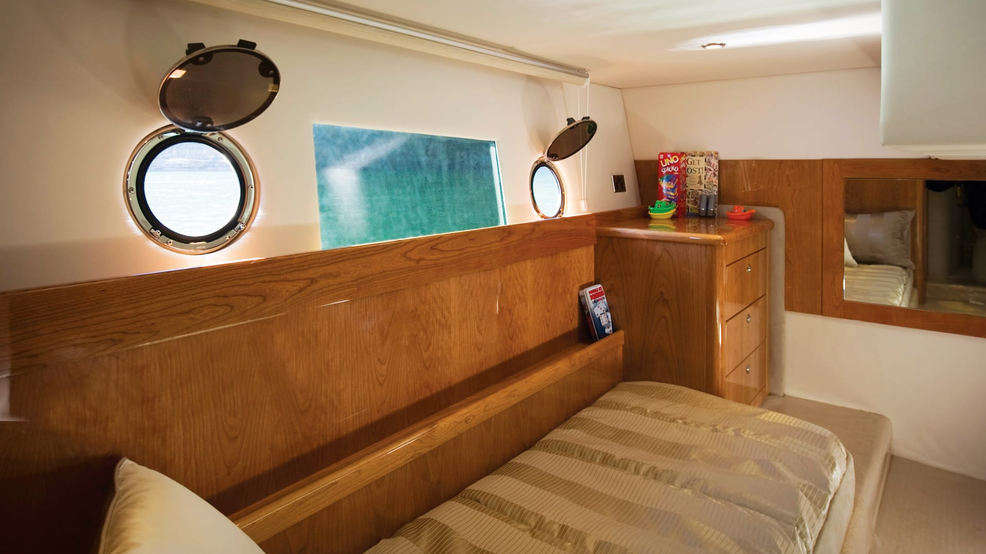 Riviera 43 Open Flybridge Guest Stateroom 02 – Gloss Cherrywood Timber Finish