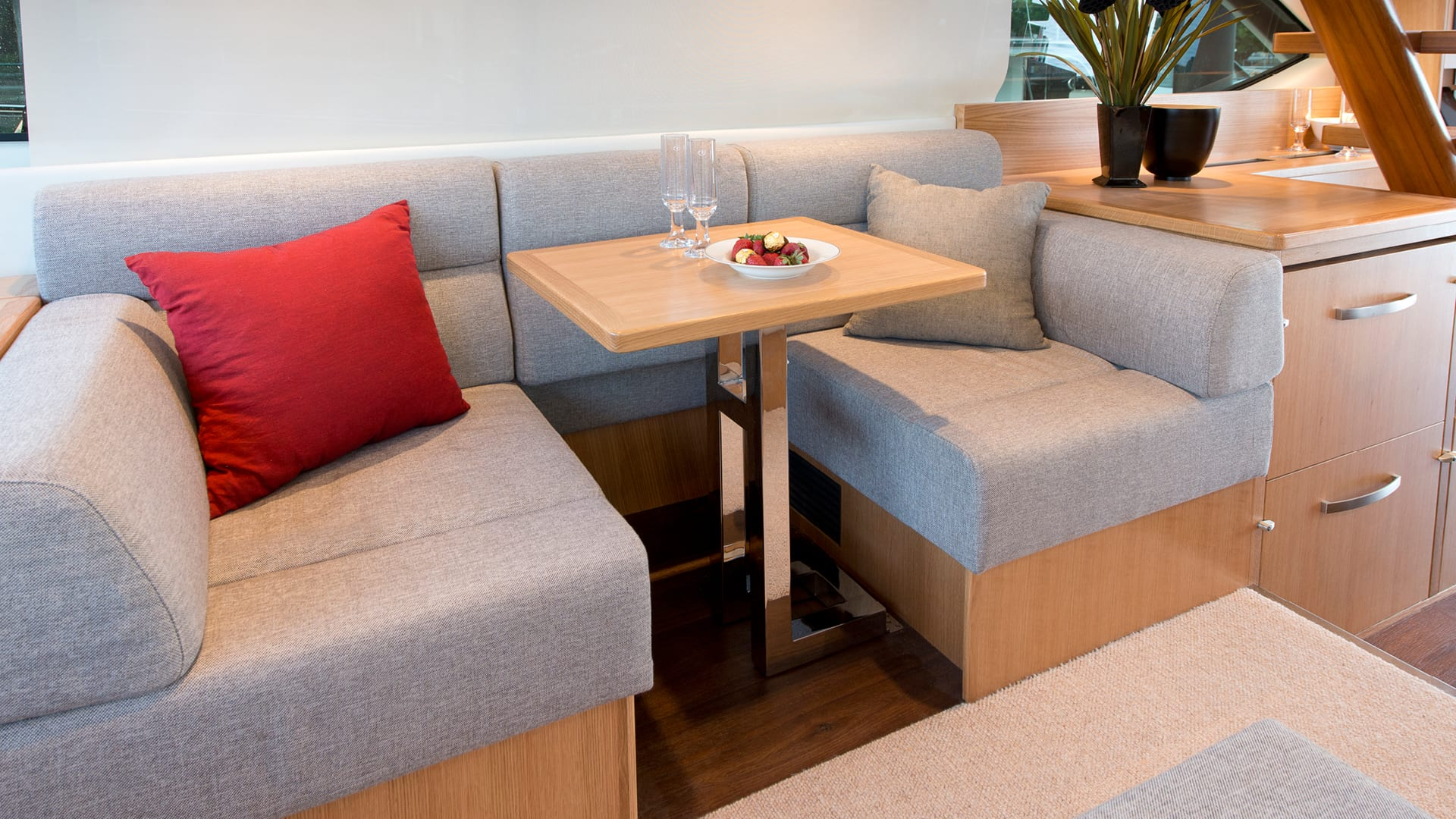 Riviera 52 Enclosed Flybridge Starboard Lounge converts into a Desk Area