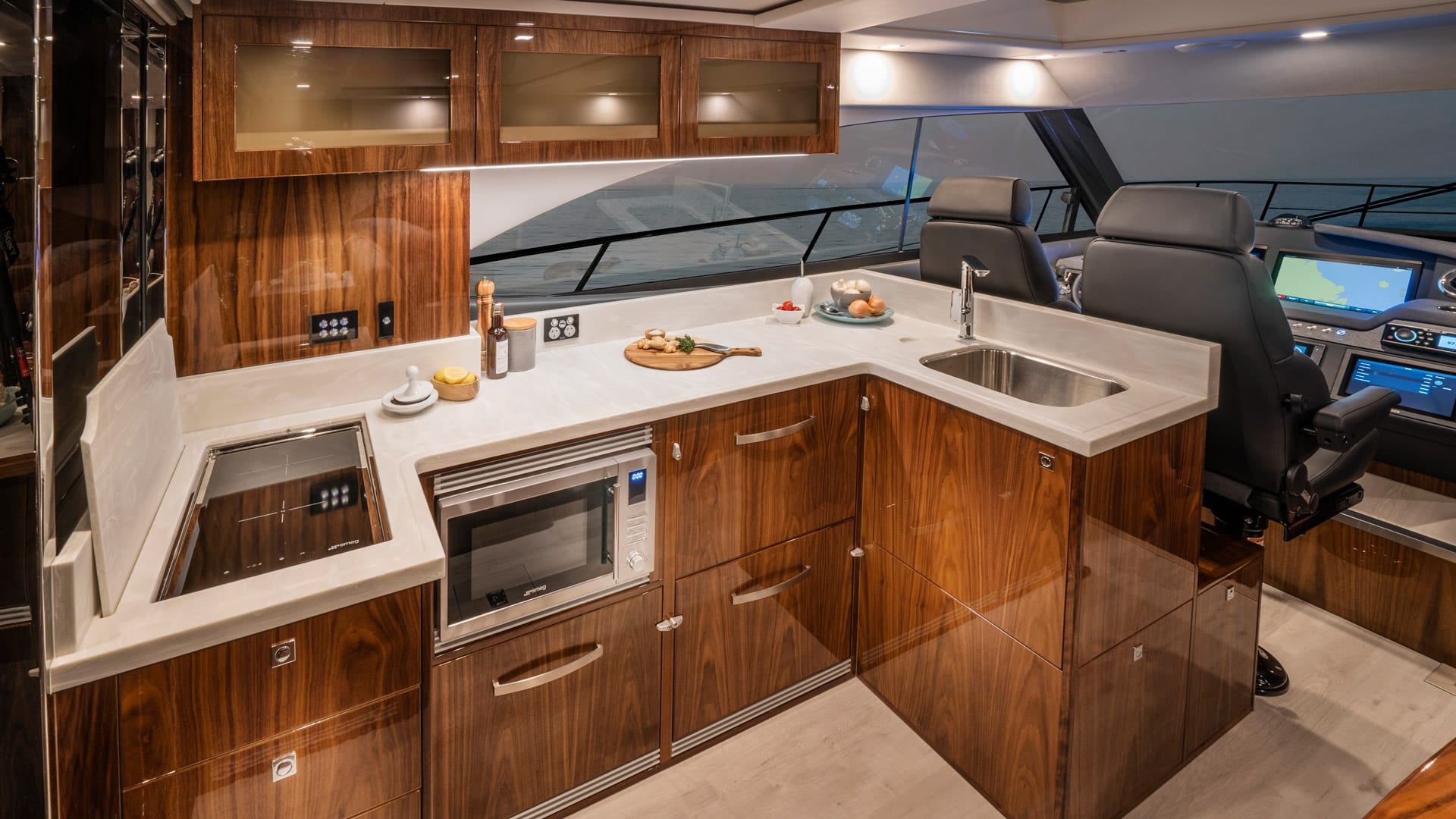 Riviera 4800 Sport Yacht Series II Platinum Edition Galley 01 – Gloss Walnut Timber Finish