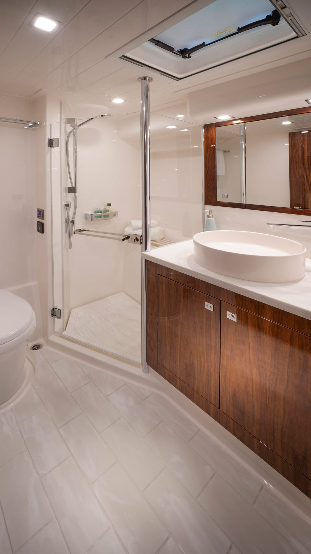 Riviera 4800 Sport Yacht Series II Platinum Edition Master Ensuite 01 – Gloss Walnut Timber Finish