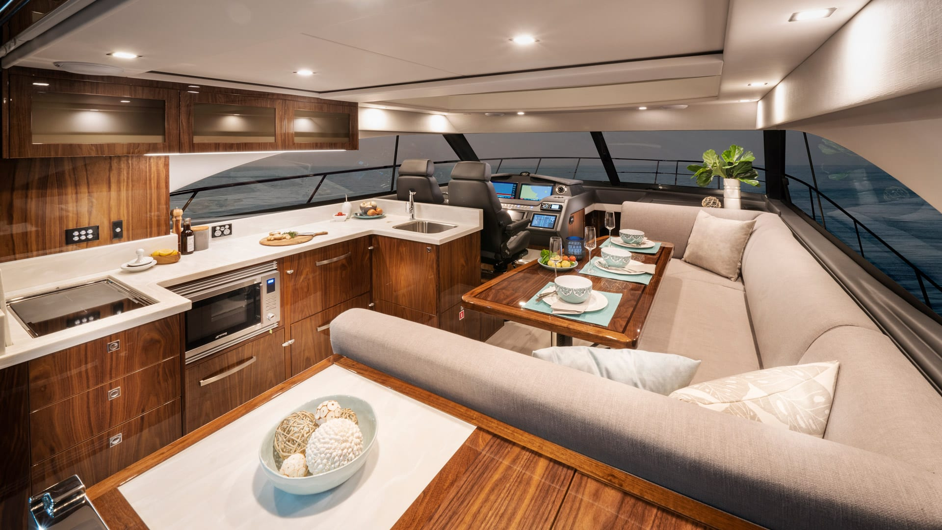 Riviera 4800 Sport Yacht Series II Platinum Edition Saloon 01 – Gloss Walnut Timber Finish