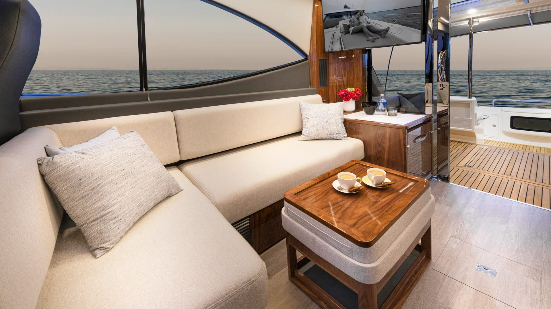 Riviera 505 SUV Starboard Lounge 01 – Gloss Walnut Timber Finish