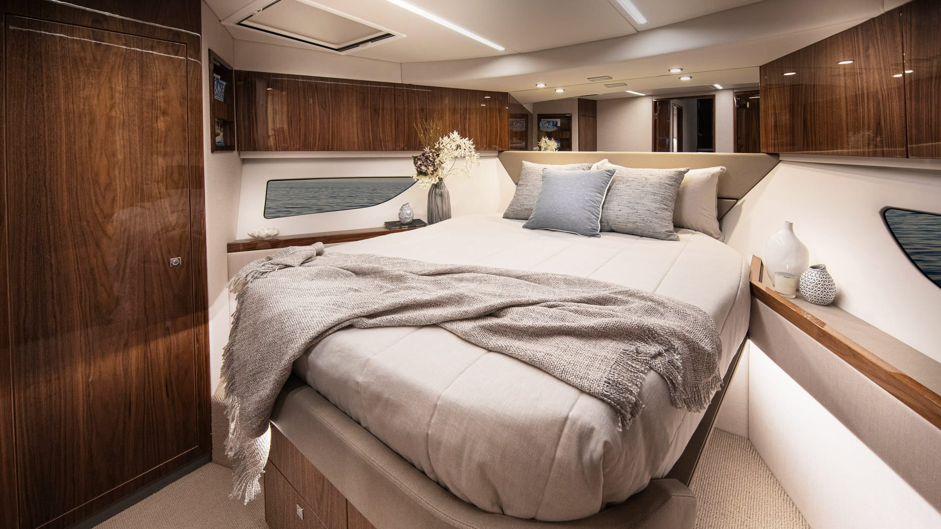 Riviera 505 SUV VIP Forward Stateroom 01 – Gloss Walnut Timber Finish