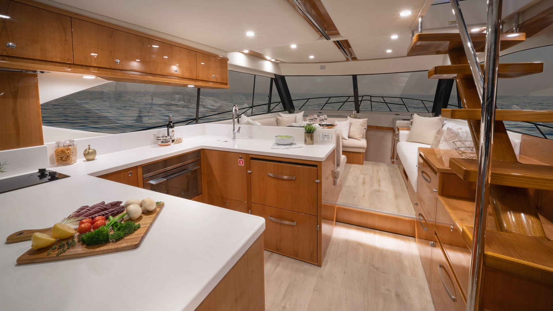 Riviera 54 Enclosed Flybridge Saloon – Gloss Cherrywood Timber Finish 02