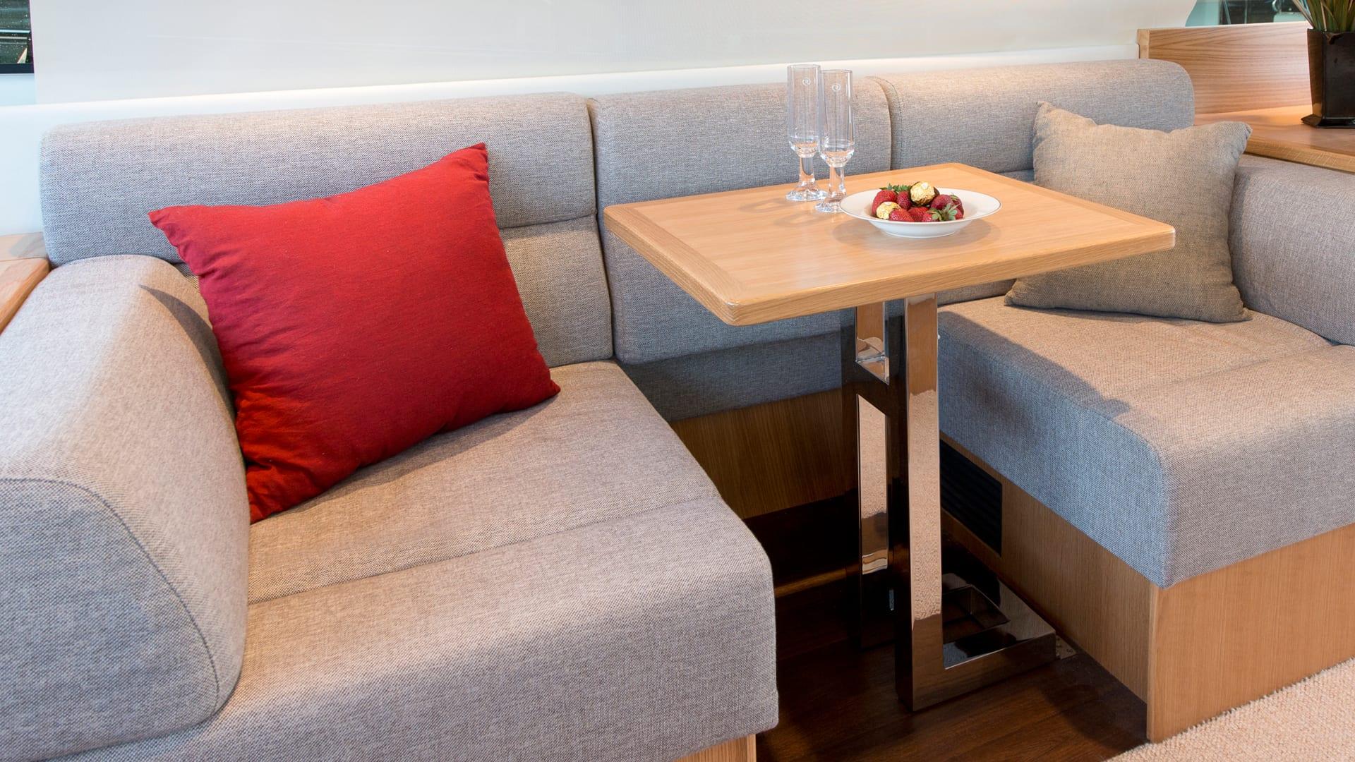 Riviera 545 SUV Starboard Lounge converts into a Desk Area
