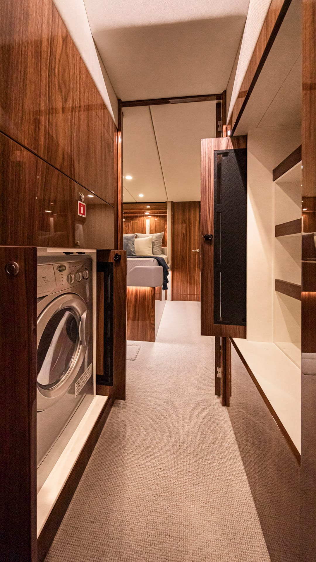 Riviera 57 Enclosed Flybridge Companionway Laundry 02 – Gloss Walnut Timber Finish