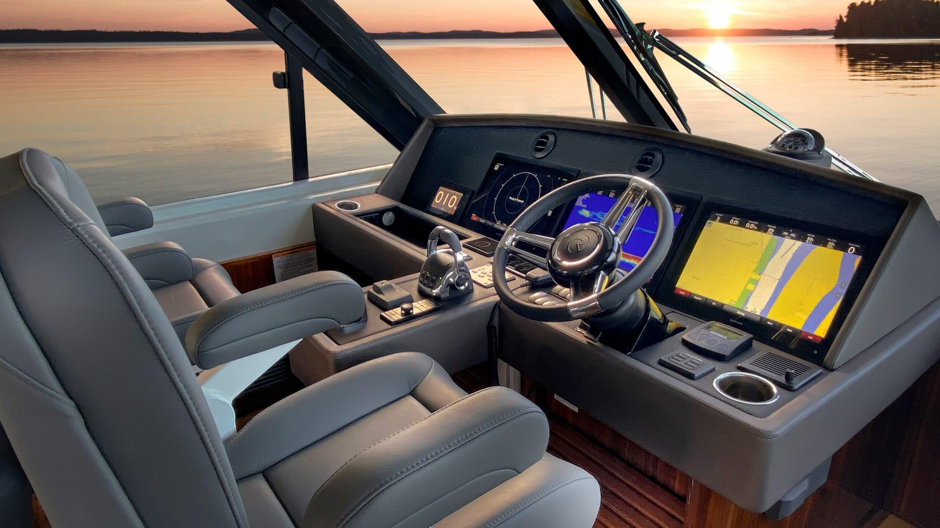 Riviera 57 Enclosed Flybridge Helm 01 – Gloss Walnut Timber Finish