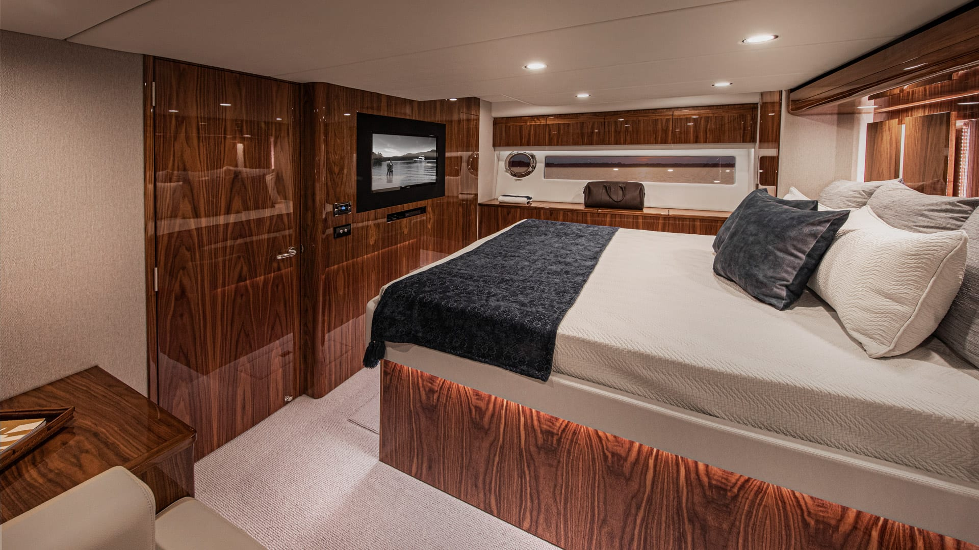 Riviera 57 Enclosed Flybridge Master Stateroom 01 – Gloss Walnut Timber Finish