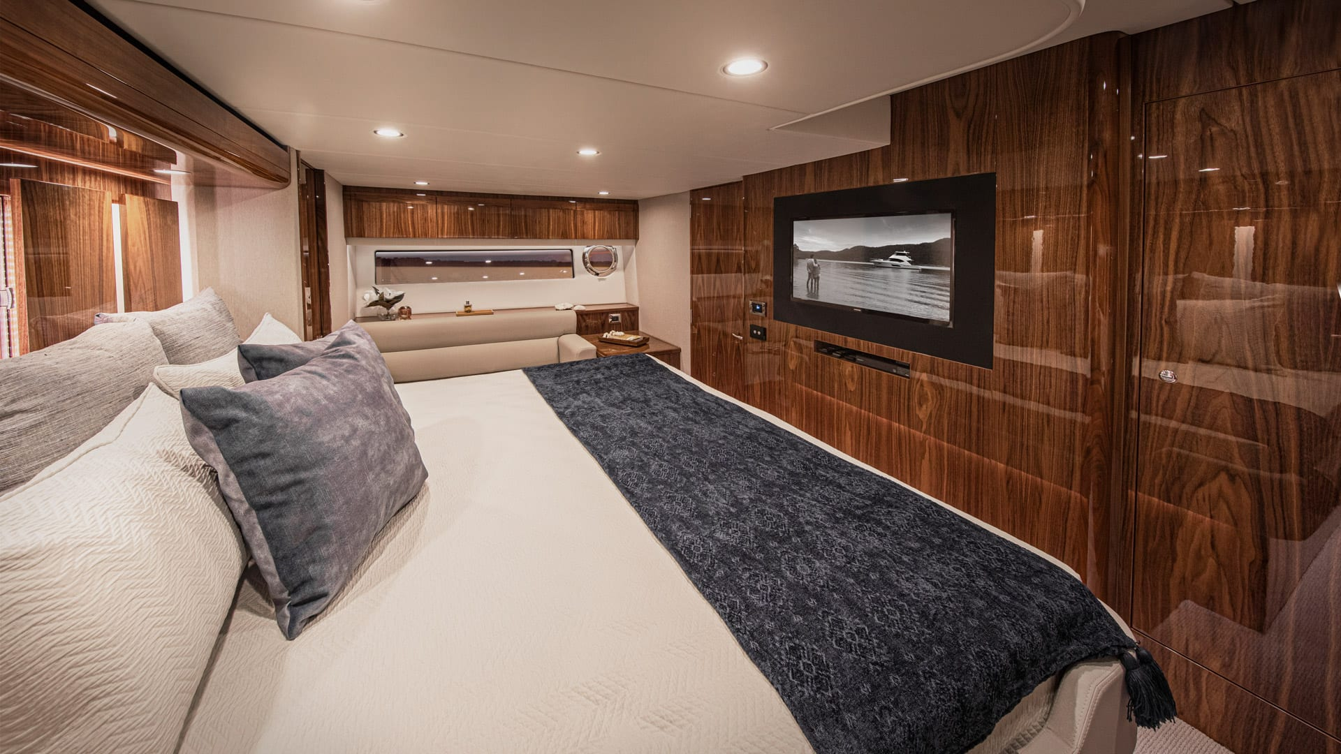 Riviera 57 Enclosed Flybridge Master Stateroom 02 – Gloss Walnut Timber Finish