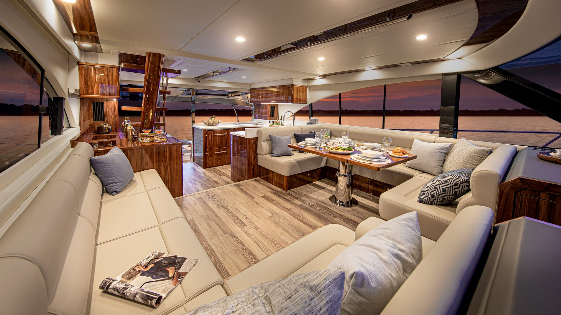Riviera 57 Enclosed Flybridge Saloon 01 – Gloss Walnut Timber Finish
