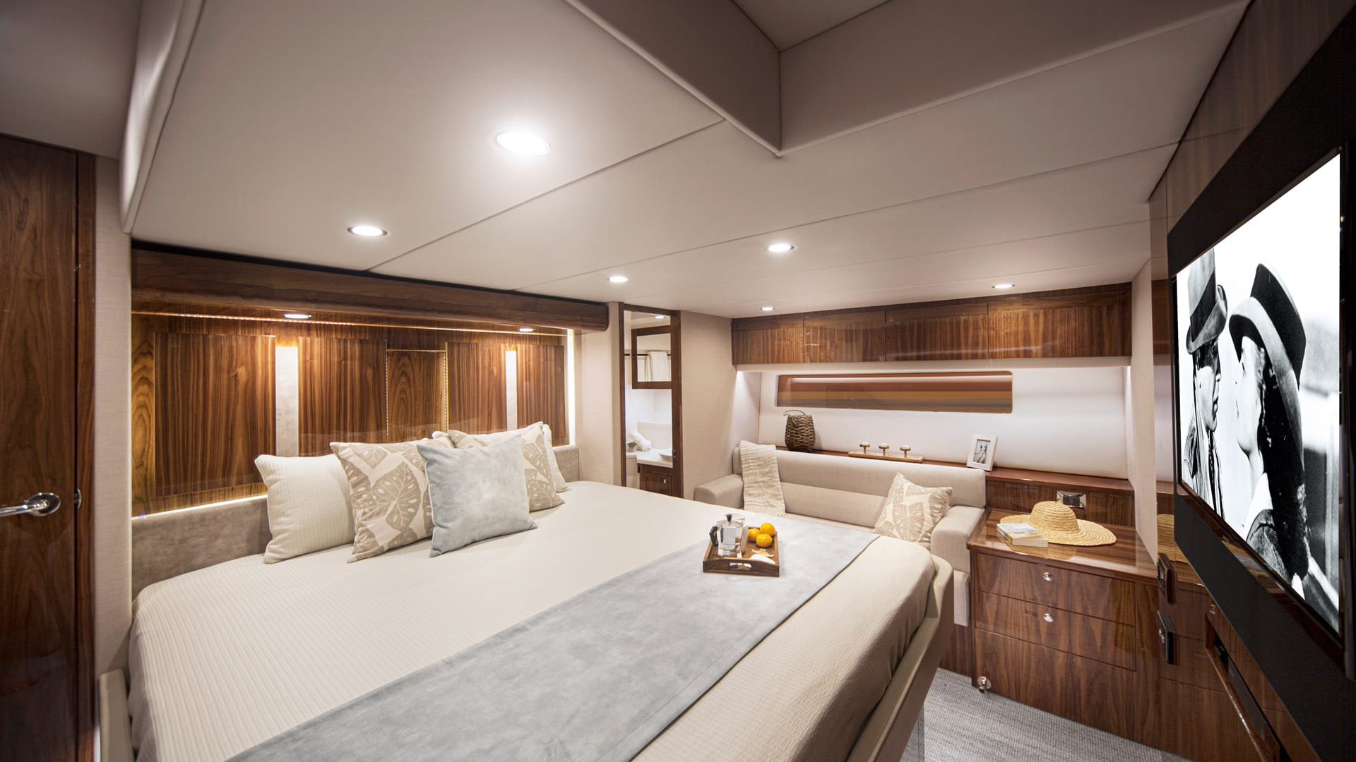 Riviera 575 SUV Master Stateroom 01 – Gloss Walnut Timber Finish