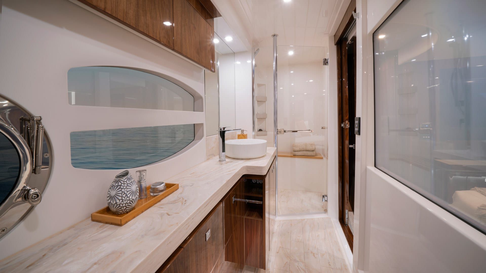Riviera 6000 Sport Yacht Platinum Edition Master Ensuite 01 – Gloss Walnut Timber Finish